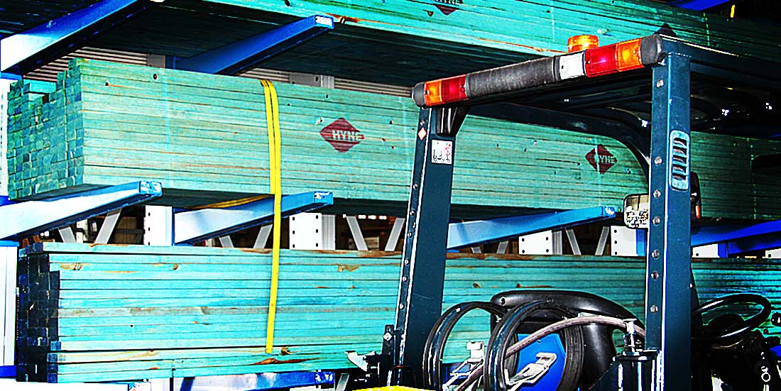 treated construction timbers in rack